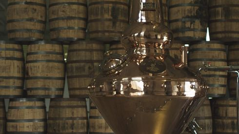 michters_pot_still_against_barrels_obpic